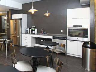 a modern white community kitchen at Ames Shovel Works in North Easton, MA