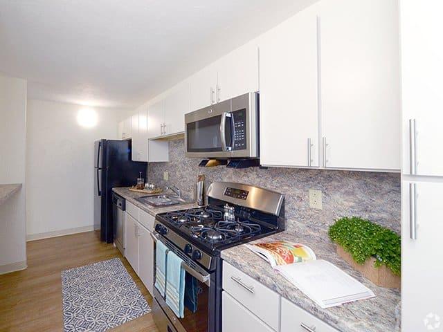 a white kitchen inside a Braintree Village apartment in Braintree, MA