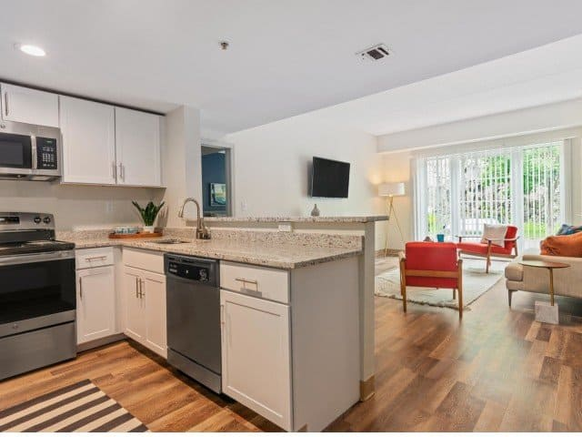 a kitchen and living area inside a Strata apartment in Malden, MA