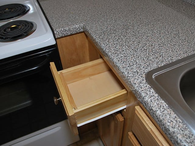 close up of a wooden drawer in a base cabinet with a laminate countertop in a Northgate apartmnet home in Revere, MA