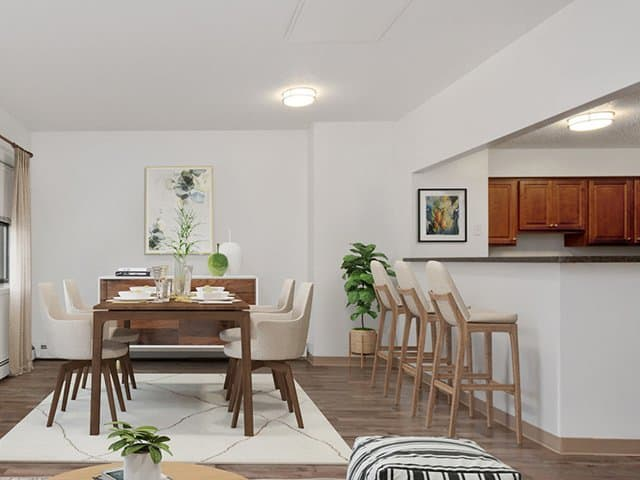 a kitchen and dining area in a Stockbridge Court apartment home in Springfield, MA