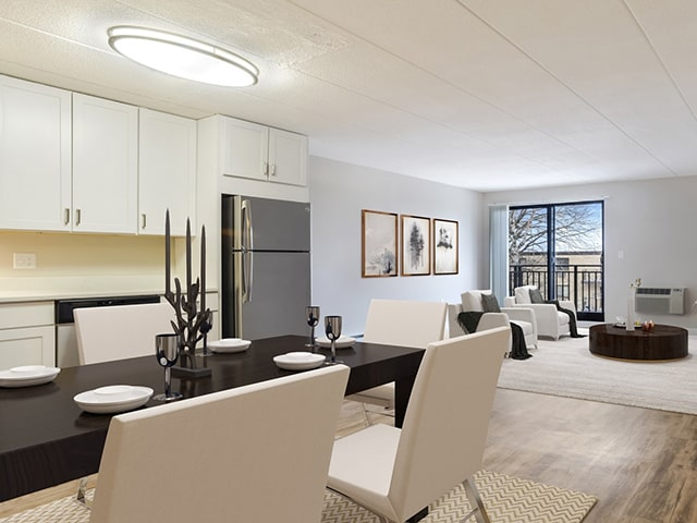 white kitchen next to living and dining space in a bayberry hill apartment